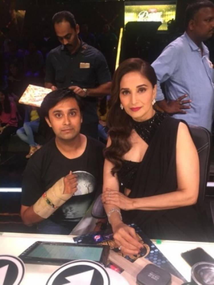 Madhuri Dixit Nene ties a rakhi to one of her fans
