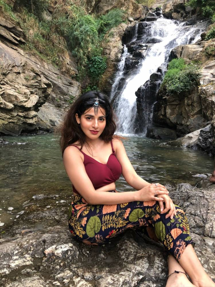 Captivating curvy beauty Actress IswaryaMenon sizzles in this latest photoshoot shot at a waterfall