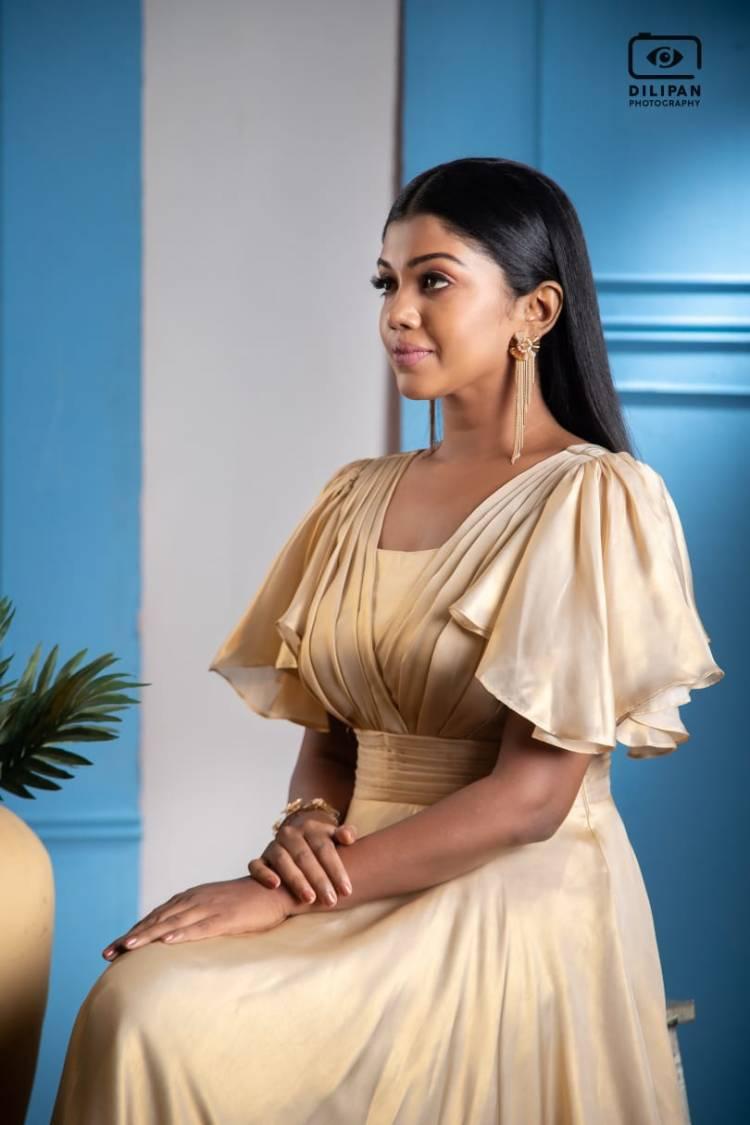 Actress Riythvika shimmers in golden hues