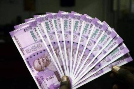 Rupee gains 12 paise against dollar