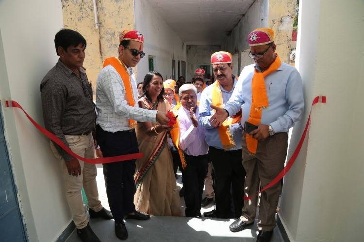 Children smile after getting newly built Classes & Toilets