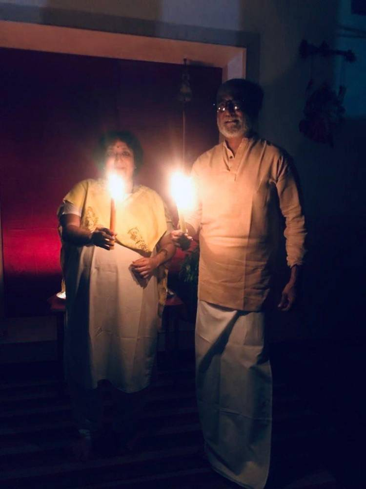 Superstar Rajinikanth poses with a candle as part of the #LightForIndia initiative by our Hon'ble PM of India